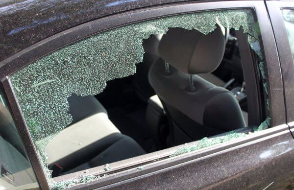 Car glass broken by perpetrators